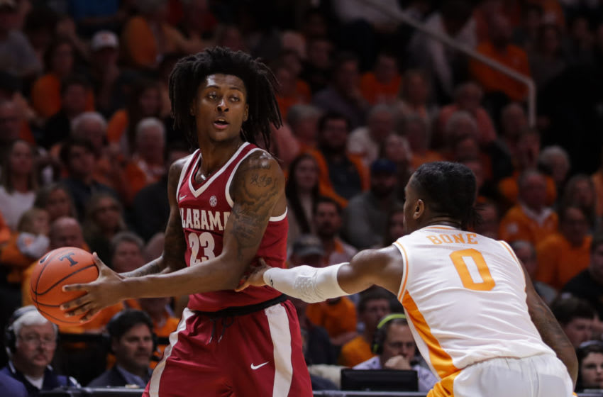 KNOXVILLE, TN - JANUARY 19: John Petty #23 of the Alabama Crimson Tide defended by Jordan Bone #0 of the Tennessee Volunteers during the first half of their game at Thompson-Boling Arena on January 19, 2019 in Knoxville, Tennessee. (Photo by Donald Page/Getty Images)
