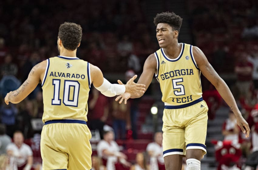 FAYETTEVILLE, AR - DECEMBER 19: Moses Wright #5 congratulates Jose Alvarado #10 of the Georgia Tech Yellow Jackets during a game against the Arkansas Razorbacks at Bud Walton Arena on December 19, 2018 in Fayetteville, Arkansas. The Yellow Jackets defeated the Razorbacks 69-65. (Photo by Wesley Hitt/Getty Images)