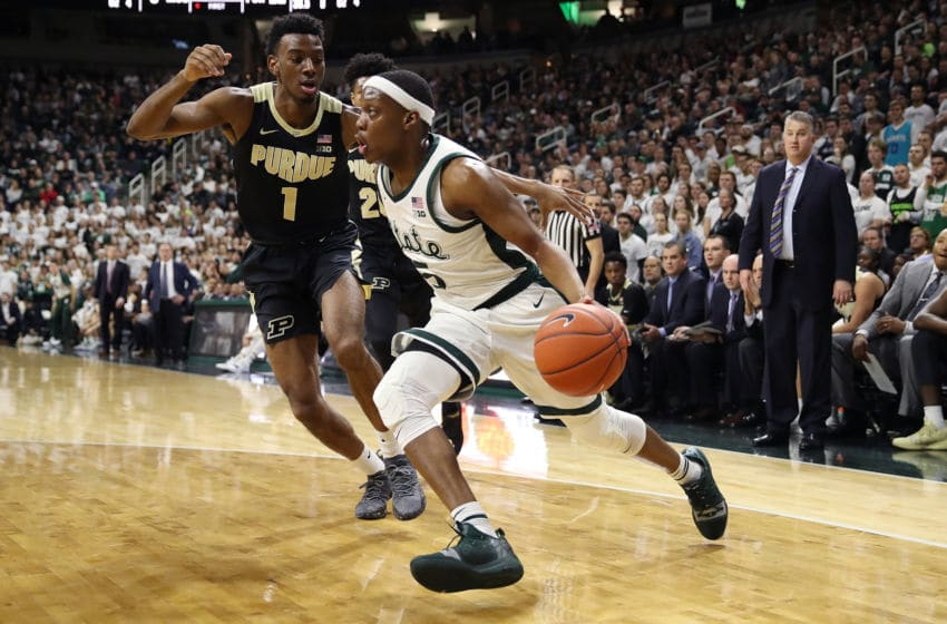 EAST LANSING, MICHIGAN - JANUARY 08: Cassius Winston #5 of the Michigan State Spartans drives around Aaron Wheeler #1 of the Purdue Boilermakers during the first half at Breslin Center on January 08, 2019 in East Lansing, Michigan. (Photo by Gregory Shamus/Getty Images)
