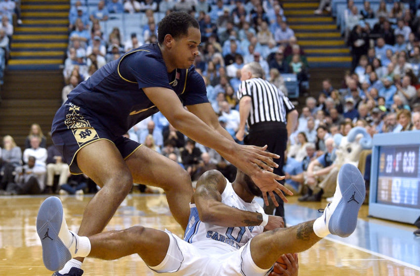 CHAPEL HILL, NORTH CAROLINA - JANUARY 15: D.J. Harvey #5 of the Notre Dame Fighting Irish battles Seventh Woods #0 of the North Carolina Tar Heels for a loose ball during the first half of a game at the Dean Smith Center on January 15, 2019 in Chapel Hill, North Carolina. (Photo by Grant Halverson/Getty Images)