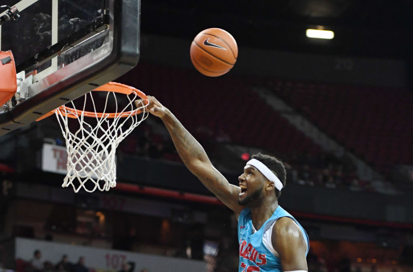 LAS VEGAS, NEVADA - JANUARY 22: Carlton Bragg #35 of the New Mexico Lobos misses a dunk and is fouled by Amauri Hardy #3 of the UNLV Rebels during their game at the Thomas & Mack Center on January 22, 2019 in Las Vegas, Nevada. The Rebels defeated the Lobos 74-58. (Photo by Ethan Miller/Getty Images)