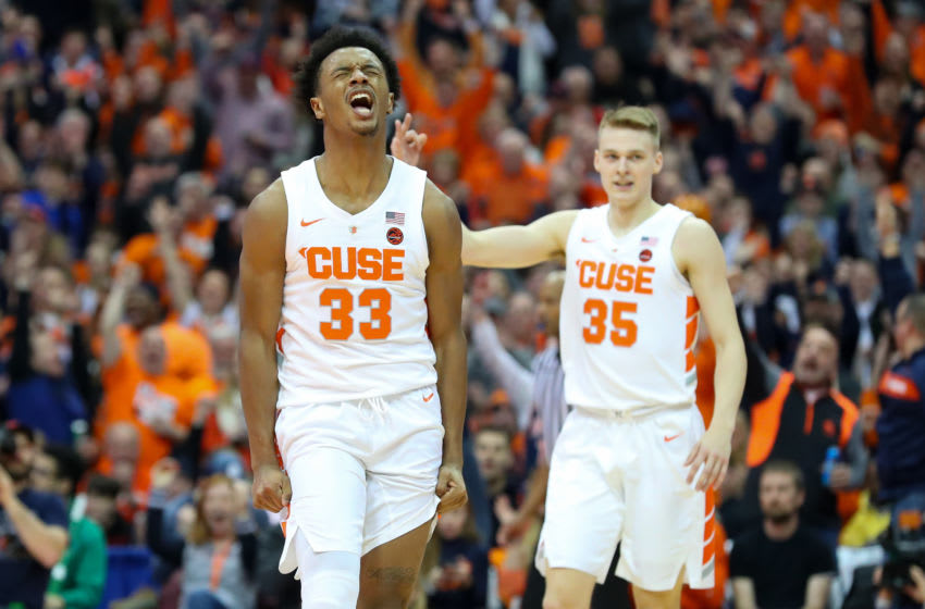 SYRACUSE, NY - FEBRUARY 20: Elijah Hughes #33 of the Syracuse Orange reacts to a made three-point basket as teammate Buddy Boeheim #35 gestures against the Louisville Cardinals during the first half at the Carrier Dome on February 20, 2019 in Syracuse, New York. (Photo by Rich Barnes/Getty Images)