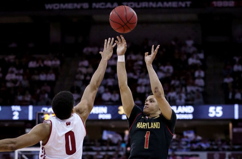 MADISON, WISCONSIN - FEBRUARY 01: Anthony Cowan Jr. #1 of the Maryland Terrapins attempts a shot while being guarded by D'Mitrik Trice #0 of the Wisconsin Badgers in the second half at the Kohl Center on February 01, 2019 in Madison, Wisconsin. (Photo by Dylan Buell/Getty Images)