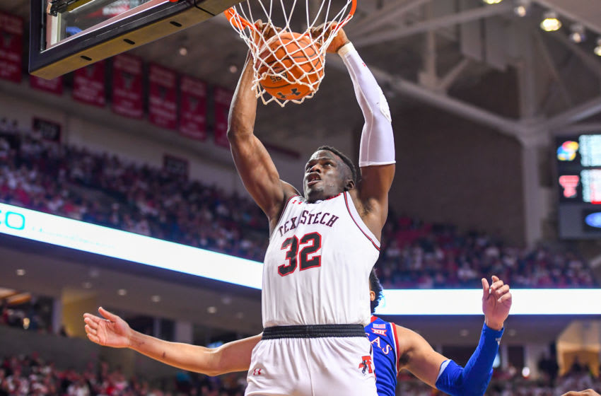 LUBBOCK, TX - FEBRUARY 23: Norense Odiase #32 of the Texas Tech Red Raiders dunks the basketball during the second half of the game against the Kansas Jayhawks on February 23, 2019 at United Supermarkets Arena in Lubbock, Texas. Texas Tech defeated Kansas 91-62. (Photo by John Weast/Getty Images)