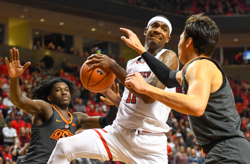 LUBBOCK, TX - FEBRUARY 27: Tariq Owens #11 of the Texas Tech Red Raiders goes to the basket against Lindy Waters III #21 of the Oklahoma State Cowboys during the second half of the game on February 27, 2019 at United Supermarkets Arena in Lubbock, Texas. Texas Tech defeated Oklahoma State 84-80 in overtime. (Photo by John Weast/Getty Images)