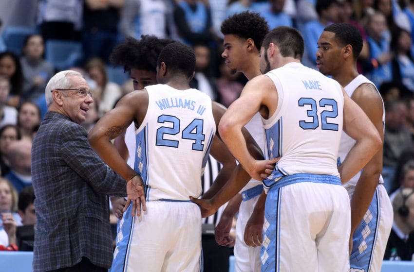 CHAPEL HILL, NORTH CAROLINA - FEBRUARY 23: Head coach Roy Williams of the North Carolina Tar Heels huddles with his starting five during the first half of their game against the Florida State Seminoles at the Dean Smith Center on February 23, 2019 in Chapel Hill, North Carolina. (Photo by Grant Halverson/Getty Images)
