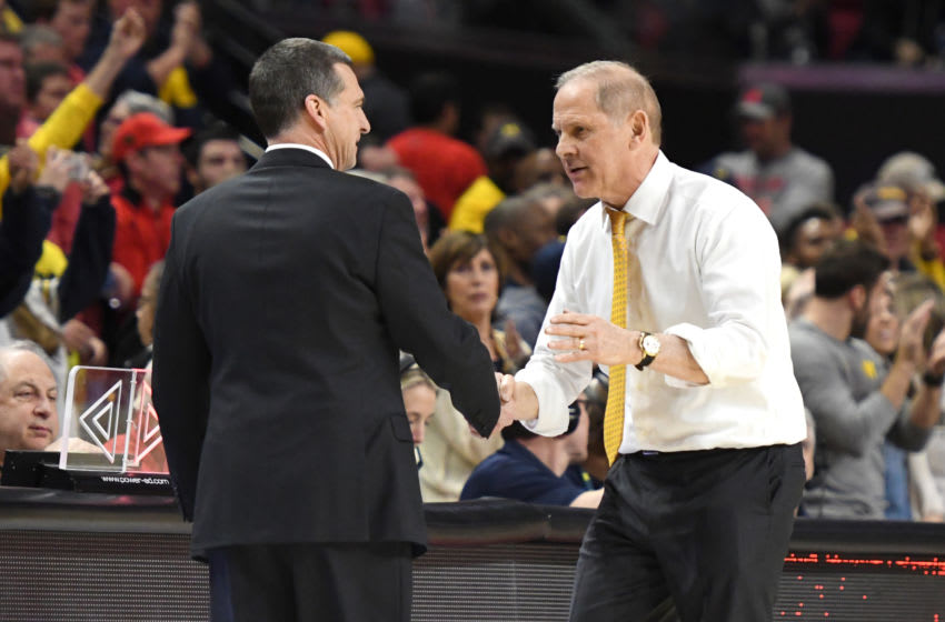 COLLEGE PARK, MD - MARCH 03: Head coach Mark Turgeon of the Maryland Terrapins and John Beilein of the Michigan Wolverines shake hands after a college basketball game at the XFinity Center on March 3, 2019 in College Park, Maryland. (Photo by Mitchell Layton/Getty Images)