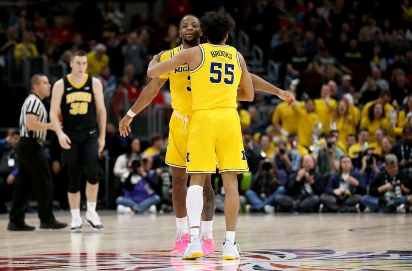 CHICAGO, ILLINOIS - MARCH 15: Zavier Simpson #3 and Eli Brooks #55 of the Michigan Wolverines celebrate in the second half against the Iowa Hawkeyes during the quarterfinals of the Big Ten Basketball Tournament at the United Center on March 15, 2019 in Chicago, Illinois. (Photo by Dylan Buell/Getty Images)