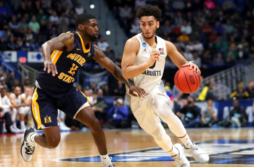 HARTFORD, CONNECTICUT - MARCH 21: Markus Howard #0 of the Marquette Golden Eagles drives the ball past Shaq Buchanan #11 of the Murray State Racers during the first round game of the 2019 NCAA Men's Basketball Tournament at XL Center on March 21, 2019 in Hartford, Connecticut. (Photo by Maddie Meyer/Getty Images)
