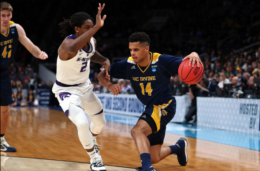 SAN JOSE, CALIFORNIA - MARCH 22: Evan Leonard #14 of the UC Irvine Anteaters dribbles the ball past Cartier Diarra #2 of the Kansas State Wildcats in the first half during the first round of the 2019 NCAA Men's Basketball Tournament at SAP Center on March 22, 2019 in San Jose, California. (Photo by Yong Teck Lim/Getty Images)