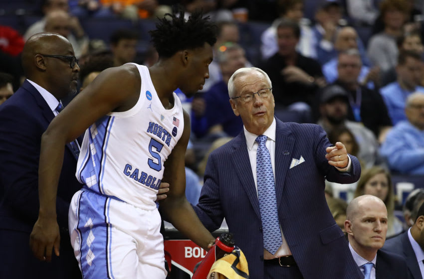 COLUMBUS, OHIO - MARCH 24: Head coach Roy Williams of the North Carolina Tar Heels speaks with Nassir Little #5 during their game against the Tennessee Volunteers in the Second Round of the NCAA Basketball Tournament at Nationwide Arena on March 24, 2019 in Columbus, Ohio. (Photo by Gregory Shamus/Getty Images)
