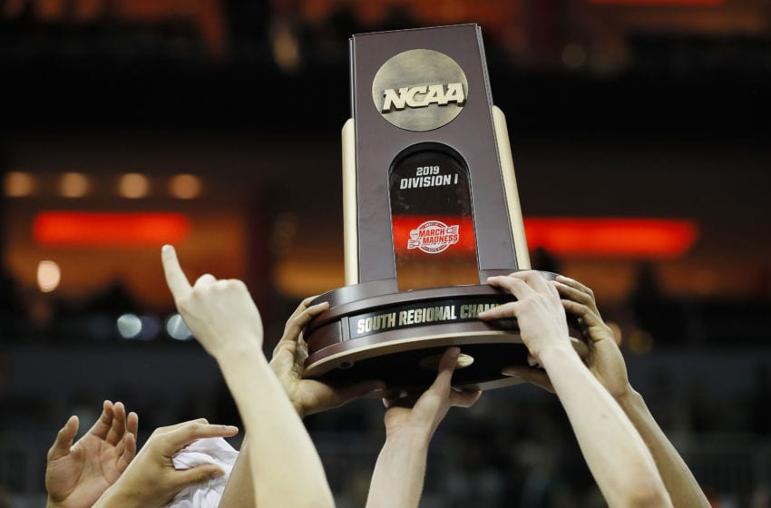LOUISVILLE, KENTUCKY - MARCH 30: The Virginia Cavaliers raise the trophy after defeating the Purdue Boilermakers 80-75 in overtime of the 2019 NCAA Men's Basketball Tournament South Regional to advance to the Final Four at KFC YUM! Center on March 30, 2019 in Louisville, Kentucky. (Photo by Kevin C. Cox/Getty Images)