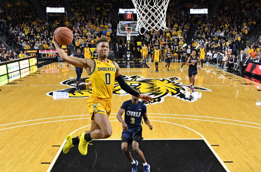 WICHITA, KS - NOVEMBER 23: Dexter Dennis #0 of the Wichita State Shockers drives to the basket for a dunk past Max Abmas #3 of the Oral Roberts Golden Eagles during the second half on November 23, 2019 at Charles Koch Arena in Wichita, Kansas. (Photo by Peter G. Aiken/Getty Images)