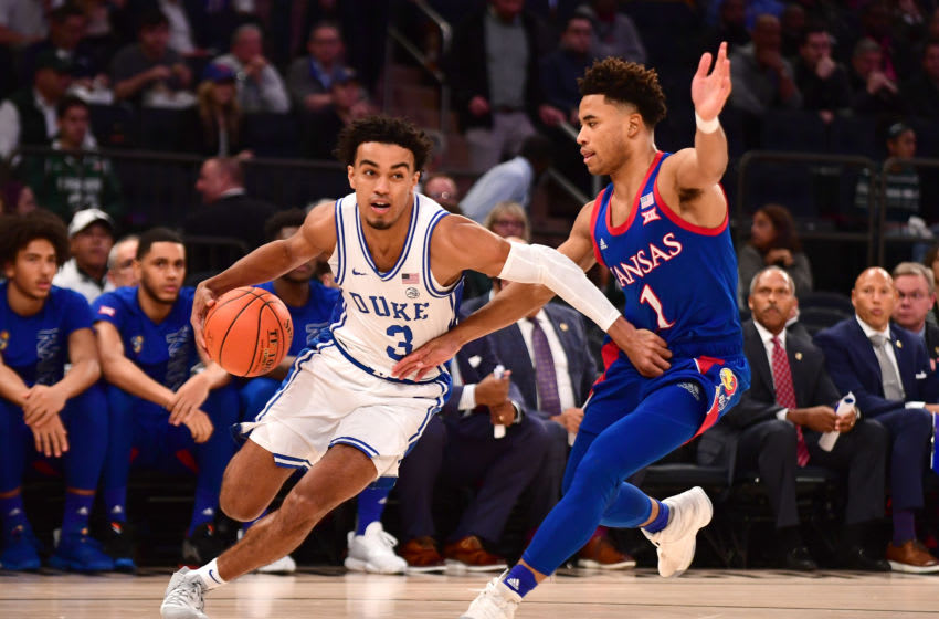 NEW YORK, NEW YORK - NOVEMBER 05: Tre Jones #3 of the Duke Blue Devils drives past Devon Dotson #1 of the Kansas Jayhawks in the first half of their game at Madison Square Garden on November 05, 2019 in New York City. (Photo by Emilee Chinn/Getty Images)