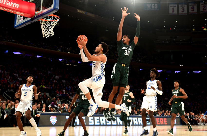 NEW YORK, NEW YORK - NOVEMBER 05: EJ Montgomery #23 of the Kentucky Wildcats drives past Marcus Bingham Jr. #30 of the Michigan State Spartans for a basket in the first half of their game at Madison Square Garden on November 05, 2019 in New York City. (Photo by Emilee Chinn/Getty Images)