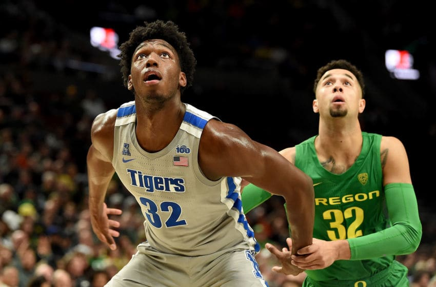PORTLAND, OREGON - NOVEMBER 12: James Wiseman #32 of the Memphis Tigers and Anthony Mathis #32 of the Oregon Ducks battle for position during the second half of the game at Moda Center on November 12, 2019 in Portland, Oregon. Oregon won the game 82-74. (Photo by Steve Dykes/Getty Images)