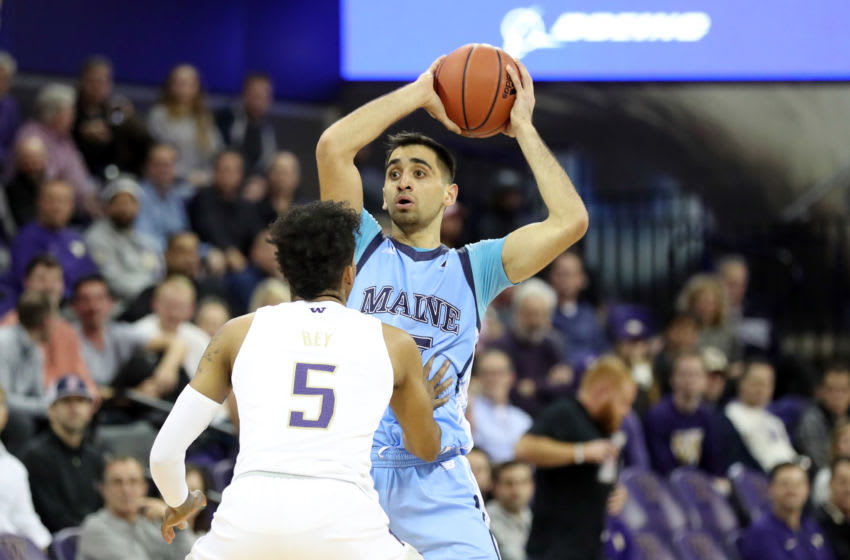 SEATTLE, WASHINGTON - NOVEMBER 19: Sergio El Darwich #25 of the Maine Black Bears looks to pass the ball against Jamal Bey #5 of the Washington Huskies in the second half during their game at Hec Edmundson Pavilion on November 19, 2019 in Seattle, Washington. (Photo by Abbie Parr/Getty Images)