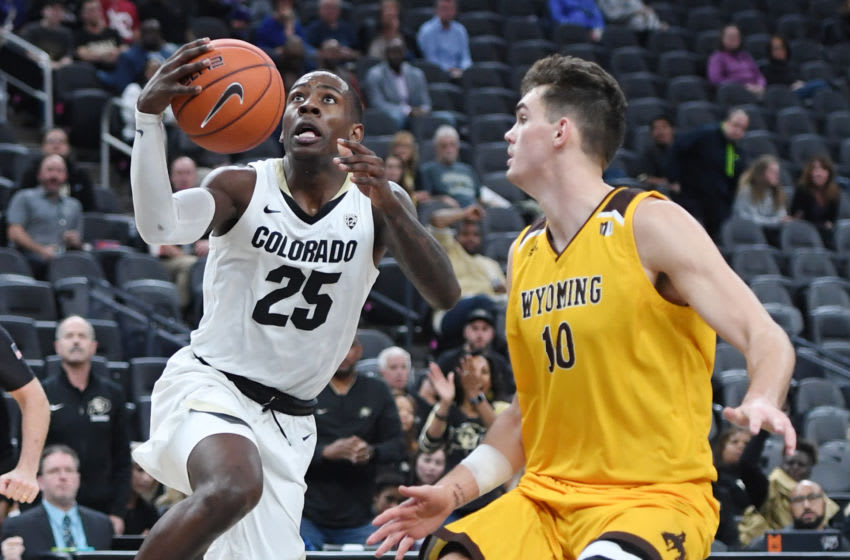 LAS VEGAS, NEVADA - NOVEMBER 24: McKinley Wright IV #25 of the Colorado Buffaloes drives to the basket against Hunter Thompson #10 of the Wyoming Cowboys during the MGM Resorts Main Event basketball tournament at T-Mobile Arena on November 24, 2019 in Las Vegas, Nevada. The Buffaloes defeated the Cowboys 56-41. (Photo by Ethan Miller/Getty Images)