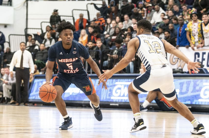 WASHINGTON, DC - NOVEMBER 16: Jameer Nelson Jr. #12 of George Washington defends gainst Sherwyn Devonish #5 of Morgan State during a game between Morgan State University and George Washington University at The Smith Center on November 16, 2019 in Washington, DC. (Photo by Tony Quinn/ISI Photos/Getty Images)