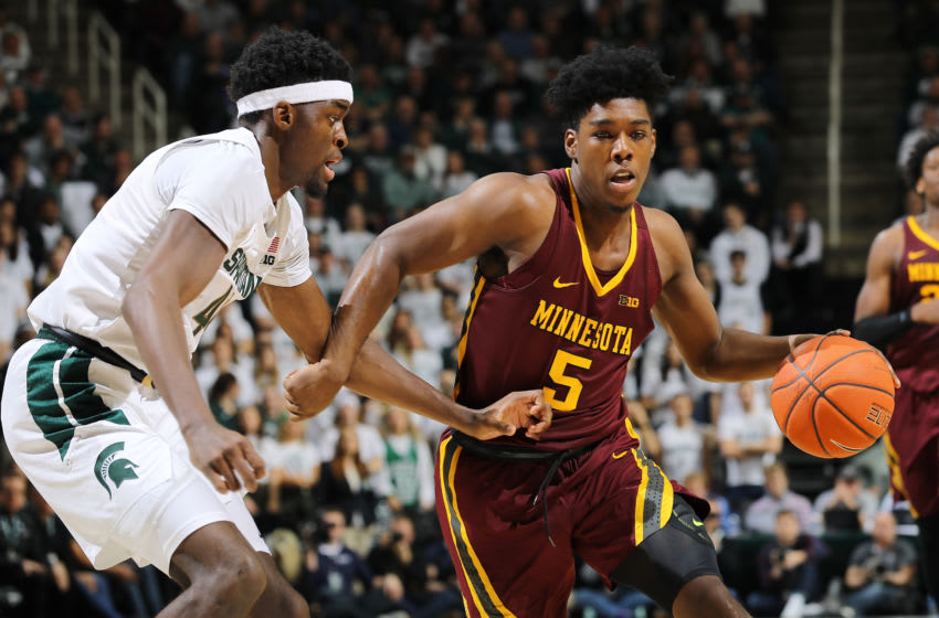 EAST LANSING, MI - JANUARY 09: Marcus Carr #5 of the Minnesota Golden Gophers drives to the basket during the second half of the game against Gabe Brown #44 of the Michigan State Spartans at the Breslin Center on January 9, 2020 in East Lansing, Michigan. (Photo by Rey Del Rio/Getty Images)