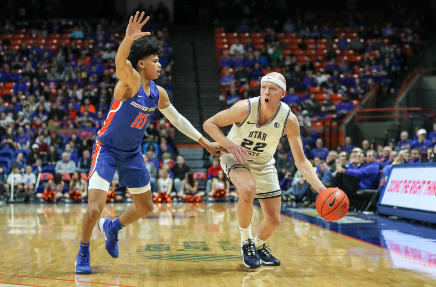 BOISE, ID - JANUARY 18: Guard Brock Miller #22 of the Utah State Aggies is pressured towards the baseline by guard RayJ Dennis #10 of the Boise State Broncos during second half action at ExtraMile Arena on January 18, 2020 in Boise, Idaho. Boise State won the game in overtime 88-83. (Photo by Loren Orr/Getty Images)