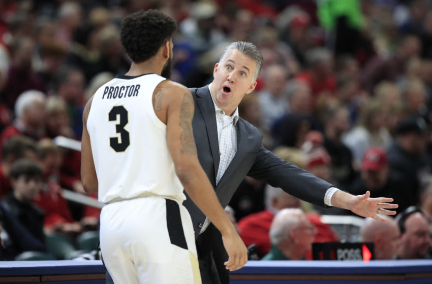 INDIANAPOLIS, INDIANA - DECEMBER 21: Matt Painter the head coach of the Purdue Boilermakers gives instructions to Jahaad Proctor #3 against the Butler Bulldogs during the Crossroads Classic at Bankers Life Fieldhouse on December 21, 2019 in Indianapolis, Indiana. (Photo by Andy Lyons/Getty Images)