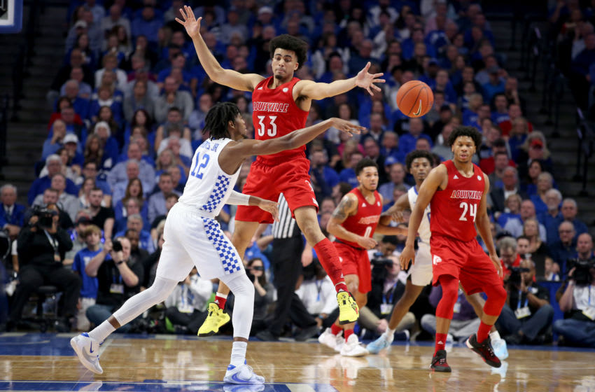LEXINGTON, KENTUCKY - DECEMBER 28: Jordan Nwora #33 of the Louisville Cardinals defends Keion Brooks Jr #12 of the Kentucky Wildcats at Rupp Arena on December 28, 2019 in Lexington, Kentucky. (Photo by Andy Lyons/Getty Images)