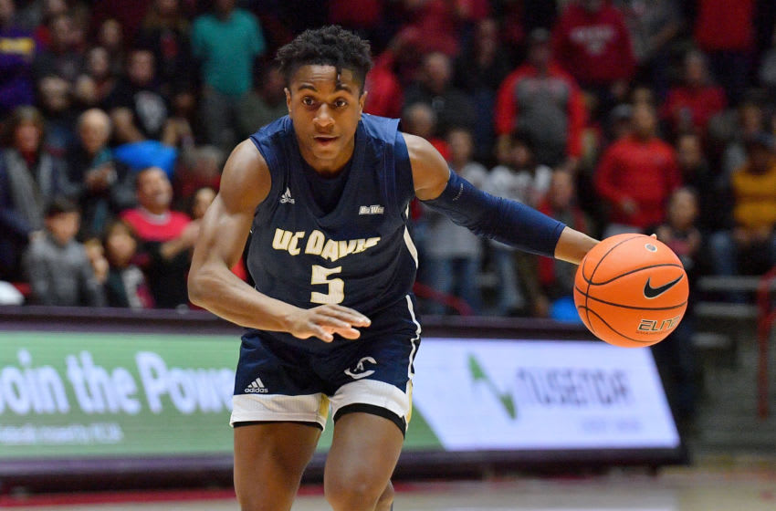 ALBUQUERQUE, NEW MEXICO - DECEMBER 29: Ezra Manjon #5 of the UC Davis Aggies dribbles against the New Mexico Lobos during their game at Dreamstyle Arena - The Pit on December 29, 2019 in Albuquerque, New Mexico. (Photo by Sam Wasson/Getty Images)