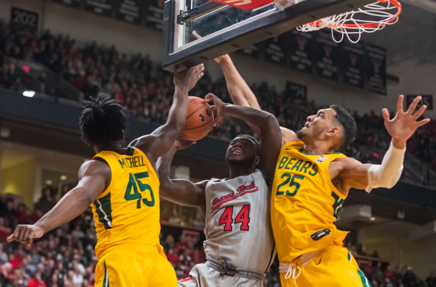 LUBBOCK, TEXAS - JANUARY 07: Guard Chris Clarke #44 of the Texas Tech Red Raiders is fouled by forward Tristan Clark #25 of the Baylor Bears during the first half of the college basketball game on January 07, 2020 at United Supermarkets Arena in Lubbock, Texas. (Photo by John E. Moore III/Getty Images)