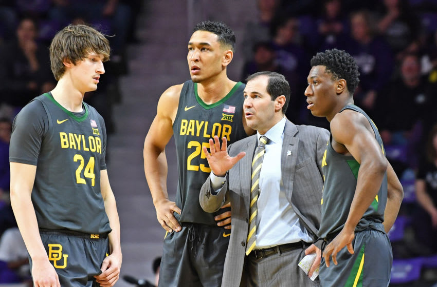 MANHATTAN, KS - FEBRUARY 03: Head coach Scott Drew of the Baylor Bears talks with players Devonte Bandoo #2, Tristan Clark #25 and Matthew Mayer #24, during the first half against the Kansas State Wildcats at Bramlage Coliseum on February 3, 2020 in Manhattan, Kansas. (Photo by Peter G. Aiken/Getty Images)