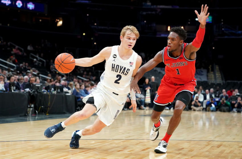 WASHINGTON, DC- JANUARY 08: Mac McClung #2 of the Georgetown Hoyas dribbles by Josh Roberts #1 of the St. John's Red Storm during a college basketball game at the Capital One Arena on January 8, 2020 in Washington, DC. (Photo by Mitchell Layton/Getty Images)