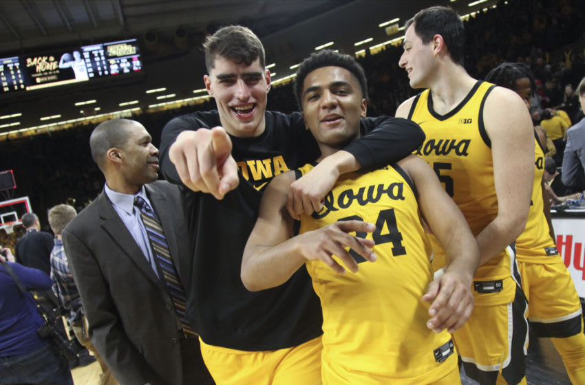 IOWA CITY, IOWA- FEBRUARY 8: Forward Luka Garza #55 and guard Nicolas Hobbs #24 of the Iowa Hawkeyes celebrate after their match-up against the Nebraska Cornhuskers, at Carver-Hawkeye Arena on February 8, 2020 in Iowa City, Iowa. (Photo by Matthew Holst/Getty Images)