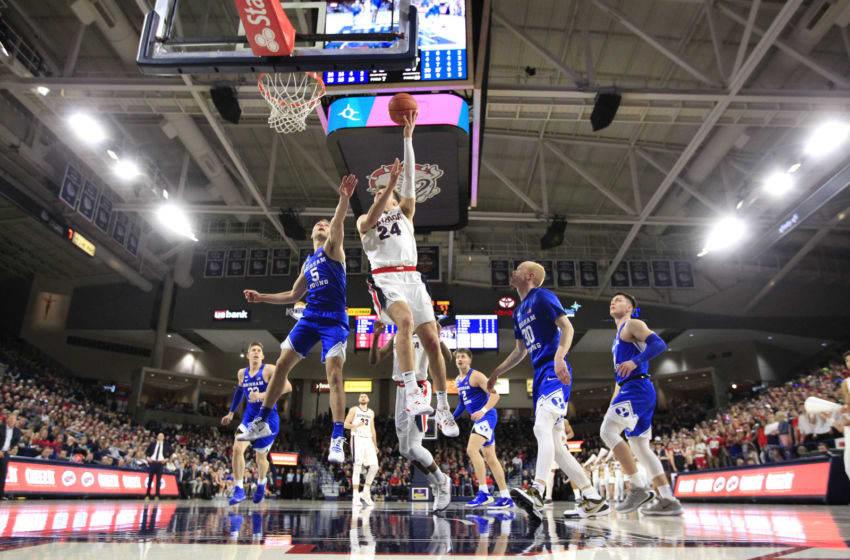 SPOKANE, WASHINGTON - JANUARY 18: Corey Kispert #24 of the Gonzaga Bulldogs goes to basket against Jake Toolson #5 of the BYU Cougars in the second half at McCarthey Athletic Center on January 18, 2020 in Spokane, Washington. Gonzaga defeats BYU 92-69. (Photo by William Mancebo/Getty Images)