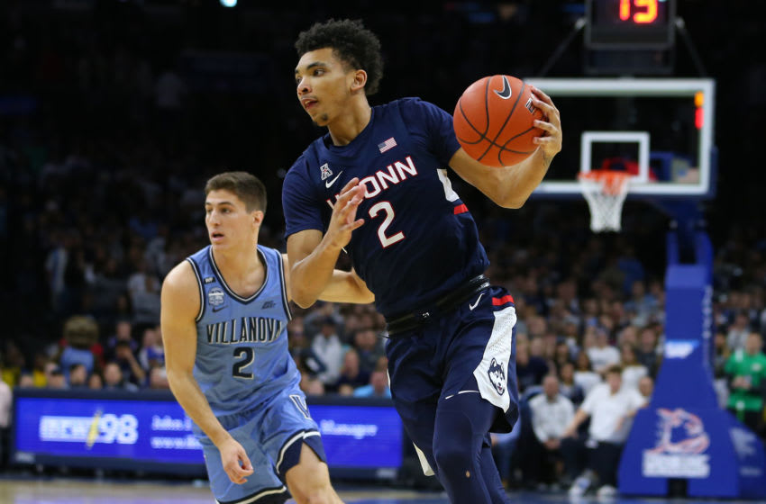 PHILADELPHIA, PA - JANUARY 18: James Bouknight #2 of the Connecticut Huskies in action against Collin Gillespie #2 of the Villanova Wildcats during a college basketball game at Wells Fargo Center on January 18, 2020 in Philadelphia, Pennsylvania. (Photo by Rich Schultz/Getty Images)