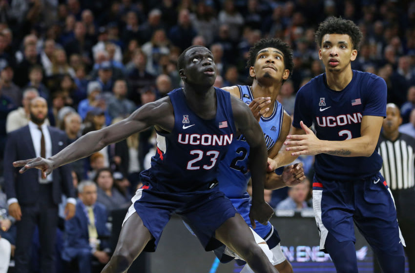 PHILADELPHIA, PA - JANUARY 18: Akok Akok #23 and Brendan Adams #10 of the Connecticut Huskies in action against Jermaine Samuels #23 of the Villanova Wildcats during a college basketball game at Wells Fargo Center on January 18, 2020 in Philadelphia, Pennsylvania. (Photo by Rich Schultz/Getty Images)
