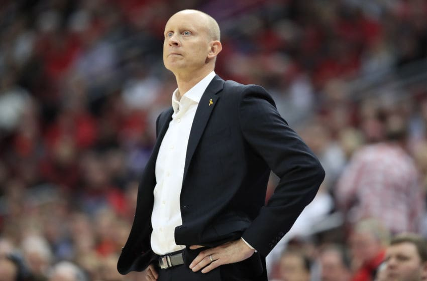 LOUISVILLE, KENTUCKY - JANUARY 25: Chris Mack the head coach of the Louisville Cardinals watches the action against the Clemson Tigers at KFC YUM! Center on January 25, 2020 in Louisville, Kentucky. (Photo by Andy Lyons/Getty Images)