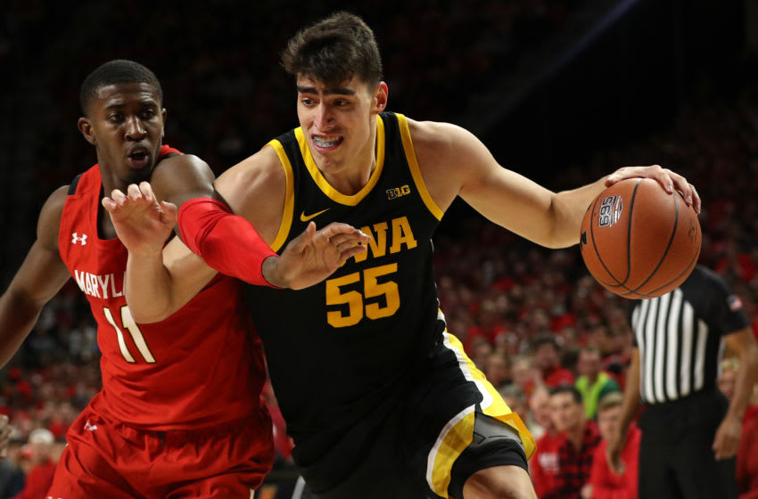 COLLEGE PARK, MARYLAND - JANUARY 30: Luka Garza #55 of the Iowa Hawkeyes dribbles past Darryl Morsell #11 of the Maryland Terrapins during the first half at Xfinity Center on January 30, 2020 in College Park, Maryland. (Photo by Patrick Smith/Getty Images)