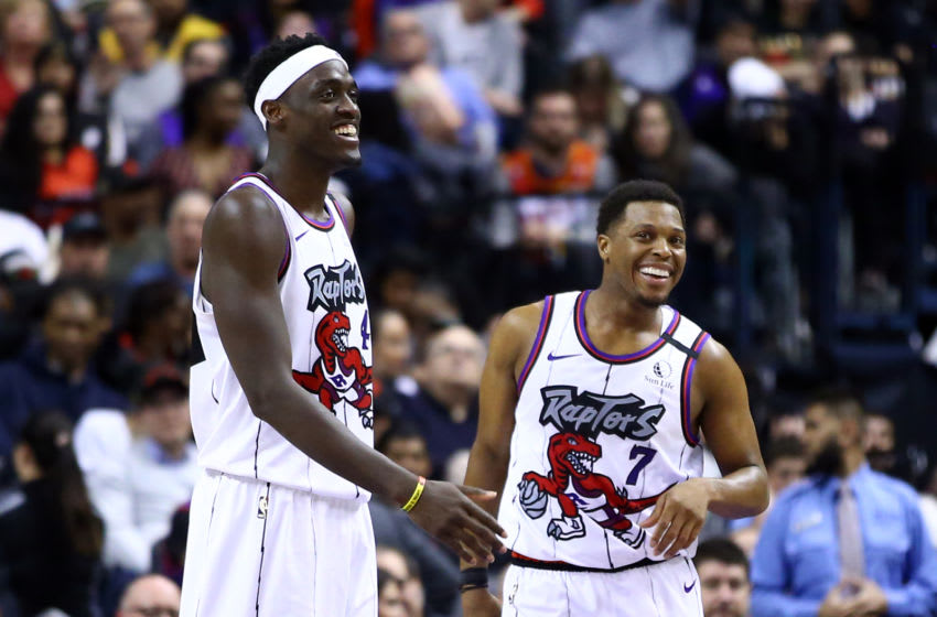 TORONTO, ON - JANUARY 28: Pascal Siakam #43 and Kyle Lowry #7 of the Toronto Raptors laugh during the second half of an NBA game against the Atlanta Hawks at Scotiabank Arena on January 28, 2020 in Toronto, Canada. NOTE TO USER: User expressly acknowledges and agrees that, by downloading and or using this photograph, User is consenting to the terms and conditions of the Getty Images License Agreement. (Photo by Vaughn Ridley/Getty Images)