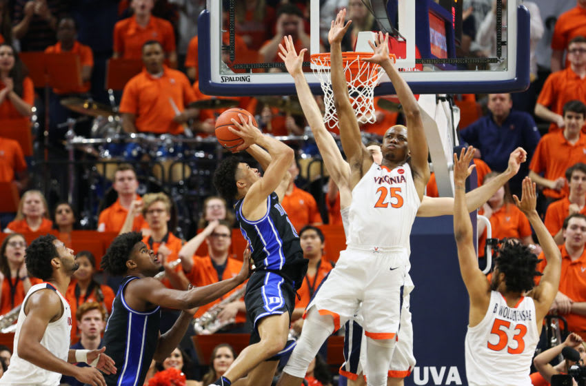 CHARLOTTESVILLE, VA - FEBRUARY 29: Mamadi Diakite #25 of the Virginia Cavaliers defends a shot by Jordan Goldwire #14 of the Duke Blue Devils in the second half during a game at John Paul Jones Arena on February 29, 2020 in Charlottesville, Virginia. (Photo by Ryan M. Kelly/Getty Images)