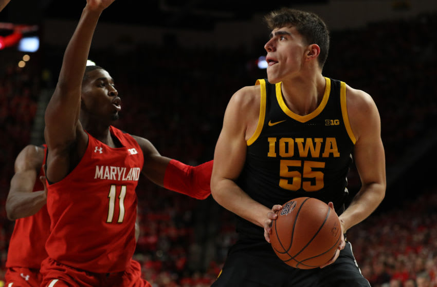 COLLEGE PARK, MARYLAND - JANUARY 30: Luka Garza #55 of the Iowa Hawkeyes in action against the Maryland Terrapins during the first half at Xfinity Center on January 30, 2020 in College Park, Maryland. (Photo by Patrick Smith/Getty Images)