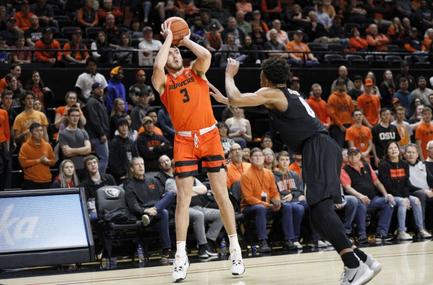 CORVALLIS, OREGON - FEBRUARY 15: Tres Tinkle #3 of the Oregon State Beavers shoots the ball over Shane Gatling #0 of the Colorado Buffaloes at Gill Coliseum on February 15, 2020 in Corvallis, Oregon. (Photo by Soobum Im/Getty Images)