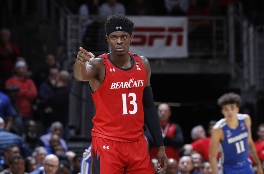 CINCINNATI, OH - FEBRUARY 13: Tre Scott #13 of the Cincinnati Bearcats looks on during a game against the Memphis Tigers at Fifth Third Arena on February 13, 2020 in Cincinnati, Ohio. Cincinnati defeated Memphis 92-86 in overtime. (Photo by Joe Robbins/Getty Images)