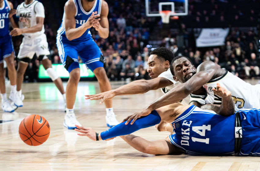 WINSTON-SALEM, NORTH CAROLINA - FEBRUARY 25: Jordan Goldwire #14 of the Duke Blue Devils and Chaundee Brown #23 of the Wake Forest Demon Deacons dive for the ball during the second half during their game at LJVM Coliseum Complex on February 25, 2020 in Winston-Salem, North Carolina. (Photo by Jacob Kupferman/Getty Images)