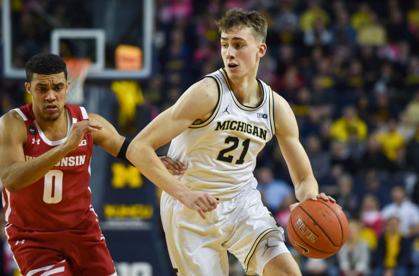 ANN ARBOR, MICHIGAN - FEBRUARY 27: Franz Wagner #21 of the Michigan Wolverines dribbles past D'Mitrik Trice #0 of the Wisconsin Badgers during the first half of a college basketball game at Crisler Arena on February 27, 2020 in Ann Arbor, Michigan. (Photo by Aaron J. Thornton/Getty Images)