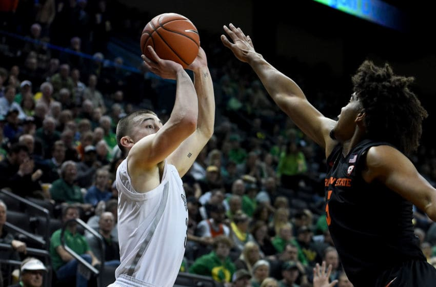 EUGENE, OREGON - FEBRUARY 27: Payton Pritchard #3 of the Oregon Ducks hits a shot over Ethan Thompson #5 of the Oregon State Beavers during the first half at Matthew Knight Arena on February 27, 2020 in Eugene, Oregon. (Photo by Steve Dykes/Getty Images)
