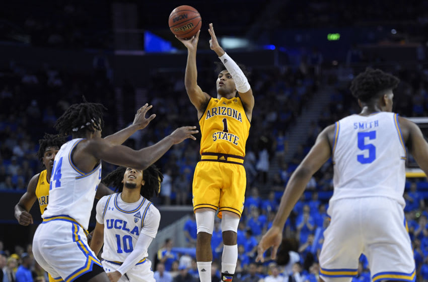 LOS ANGELES, CA - FEBRUARY 27: Remy Martin #1 of the Arizona State Sun Devils shoots over Jalen Hill #24 of the UCLA Bruins at Pauley Pavilion on February 27, 2020 in Los Angeles, California. (Photo by John McCoy/Getty Images)