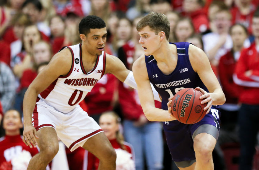 MADISON, WISCONSIN - MARCH 04: Miller Kopp #10 of the Northwestern Wildcats dribbles the ball while being guarded by D'Mitrik Trice #0 of the Wisconsin Badgers in the second half at the Kohl Center on March 04, 2020 in Madison, Wisconsin. (Photo by Dylan Buell/Getty Images)