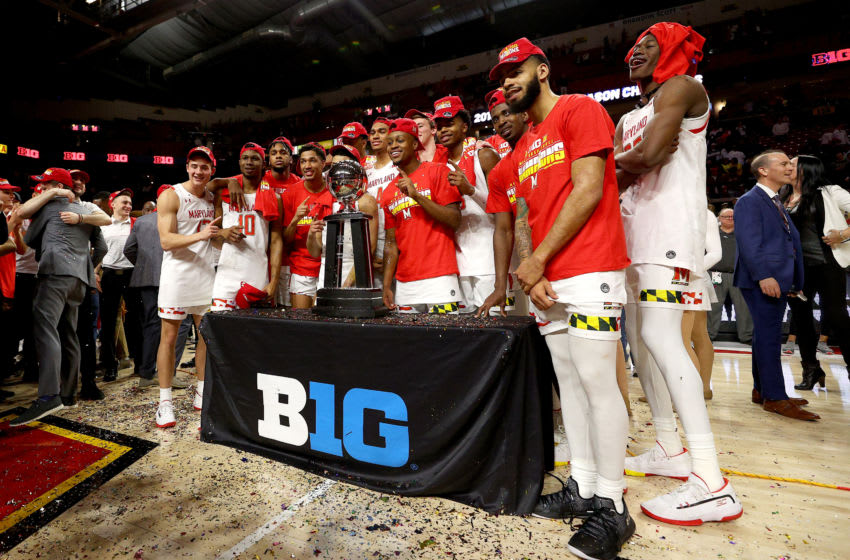 COLLEGE PARK, MARYLAND - MARCH 08: Members of the Maryland Terrapins celebrate with the trophy after defeating the Michigan Wolverines 83-70 to clinch a share of the Big Ten regular season title at Xfinity Center on March 08, 2020 in College Park, Maryland. (Photo by Rob Carr/Getty Images)