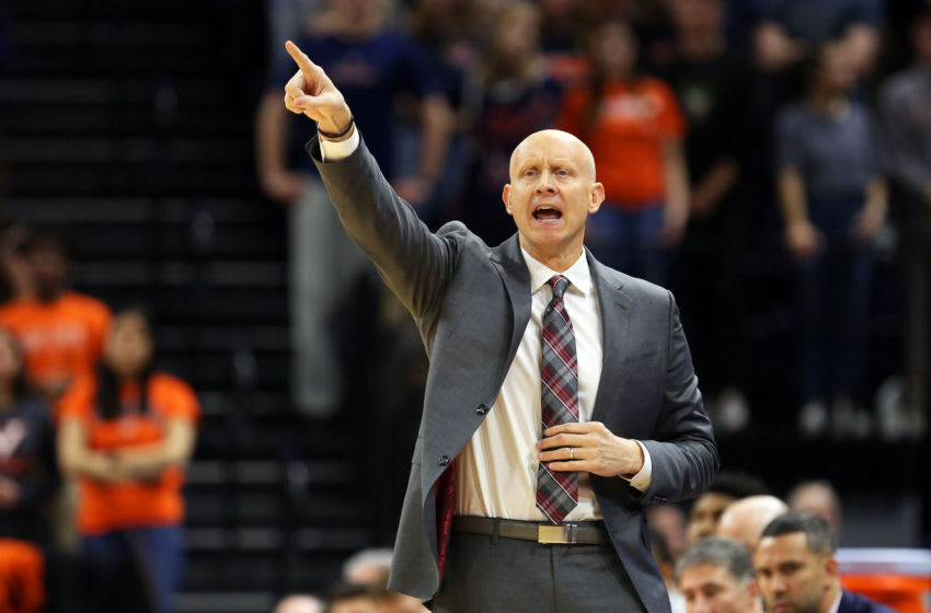 CHARLOTTESVILLE, VA - MARCH 07: Head coach Chris Mack of the Louisville Cardinals calls a play in the first half during a game against the Virginia Cavaliers at John Paul Jones Arena on March 7, 2020 in Charlottesville, Virginia. (Photo by Ryan M. Kelly/Getty Images)