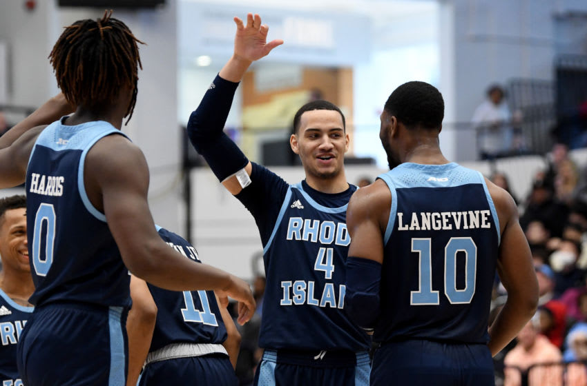 WASHINGTON, DC - FEBRUARY 08: Tyrese Martin #4 of the Rhode Island Rams celebrates with teammates during the game against the George Washington Colonials at Charles E. Smith Athletic Center on February 8, 2020 in Washington, DC. (Photo by G Fiume/Getty Images)